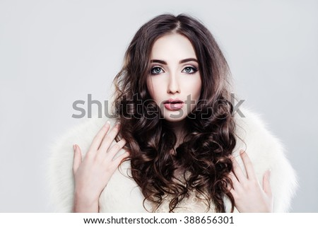 Cute Woman with Curly Brown Hairstyle - stock photo