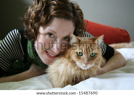 Cute Woman with her Cat - stock photo