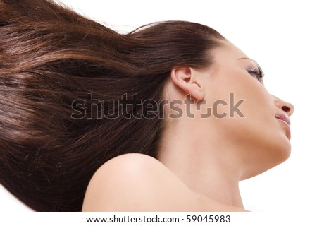 cute woman with long hair in the wind looking on one side. point of view from down