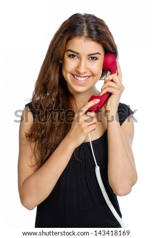 Cute woman with red wired phone on white background - stock photo