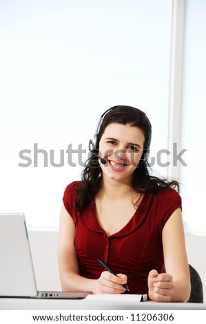 cute woman worker in an office with a headset - stock photo