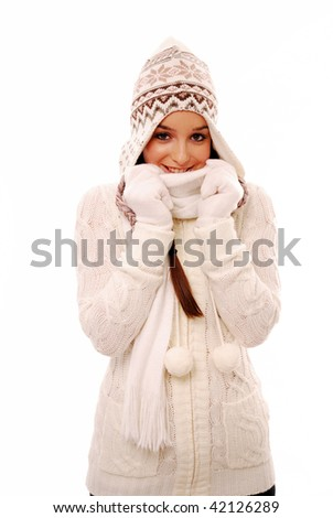 Cute woman wrapped up warm in winter clothes - stock photo