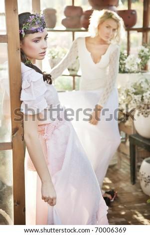 Cute women in garden - stock photo