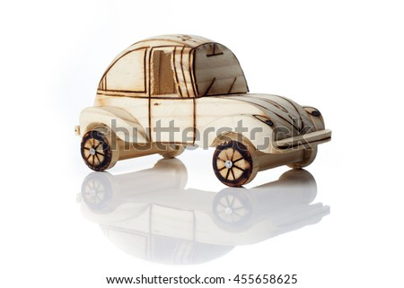 Cute wooden car toy isolated over a white background. - stock photo