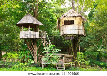 Cute wooden tree house for kids in tropical forest - stock photo