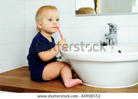 cute year-old boy brushes teeth