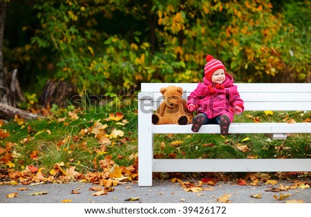 Cute 1 year old girl outdoors at autumn day - stock photo