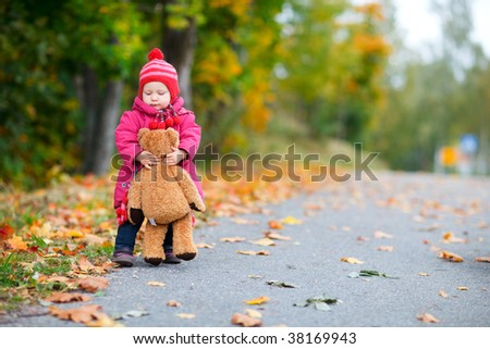 Cute 1 year old girl walking outdoors at autumn day - stock photo