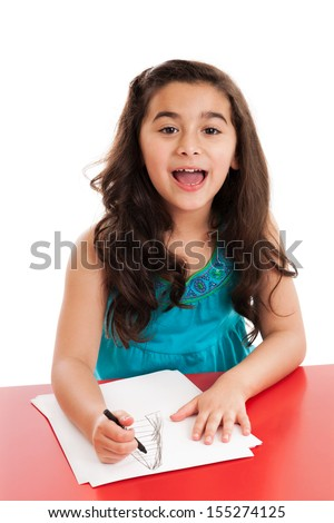 Cute 7 year old mixed race girl drawing a picture isolated on white