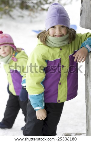 Cute 8-year-old outside in the snow. - stock photo