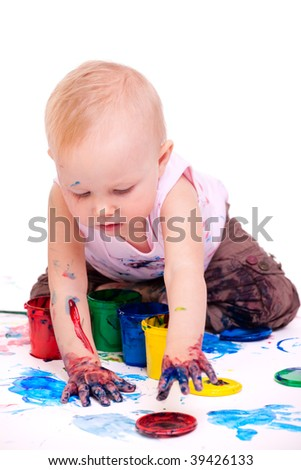 Cute 1 year old toddler girl painting on white background - stock photo
