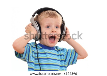 cute 3-4 years old boy listening music isolated on white - stock photo