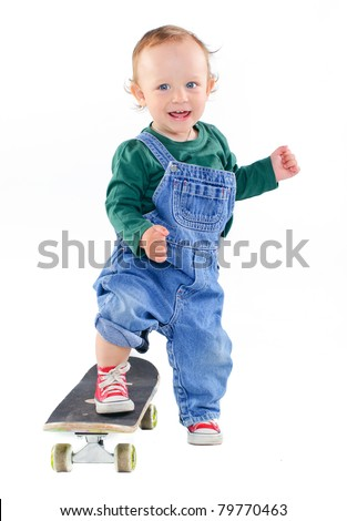 Cute 1 years old boy on a skateboard in the studio