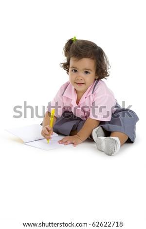 cute 2 years old girl writing something, isolated on white background - stock photo