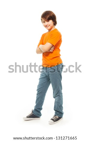 Cute 11 years old very confident boy isolated on white, full height portrait - stock photo