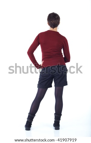 Cute young adult caucasian woman with short hair in a red top, black shorts and stockings on a white background in various poses, with various facial expressions. Not Isolated - stock photo