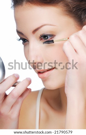 Cute young adult woman  applying mascara - beauty concept