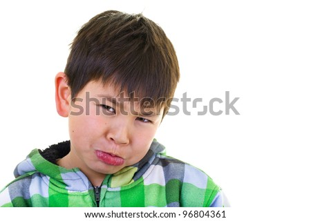 Cute young asian boy making a silly pouting face isolated on white background