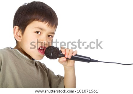 Cute young asian boy singing into a microphone isolated on a white background