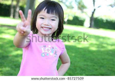 Cute young asian girl in the park having fun - stock photo