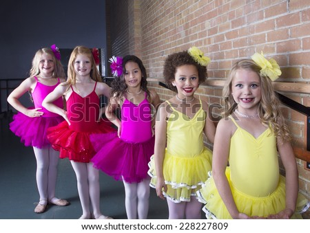 Cute young ballerinas at a dance studio (diverse group of girls) - stock photo
