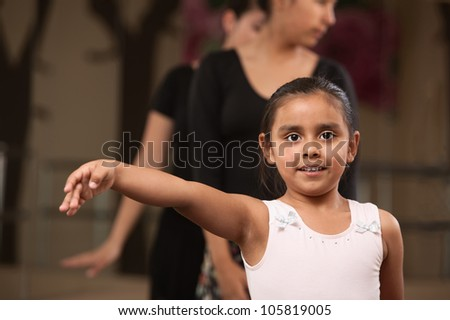 Cute young ballet student practicing in a dance studio - stock photo