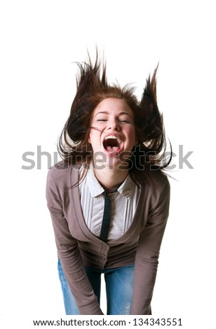 Cute young beautiful girl model wearing blue jeans, striped shirt and jumper, shaking her long hair and shouting with a loud and happy scream, mouth open, toothy smile. Isolated on white, copy space