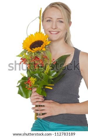 cute young blond woman with sunflower bouquet - stock photo