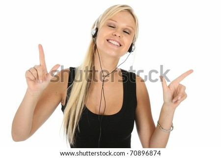 Cute young blonde lady enjoying music on earphones - stock photo