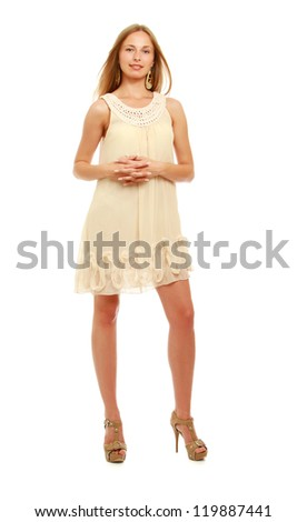Cute young blonde woman posing in stylish dress. Full length portrait isolated on white background - stock photo