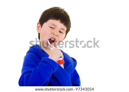 Cute young boy brushing his teeth fresh out of the shower isolated on white background - stock photo