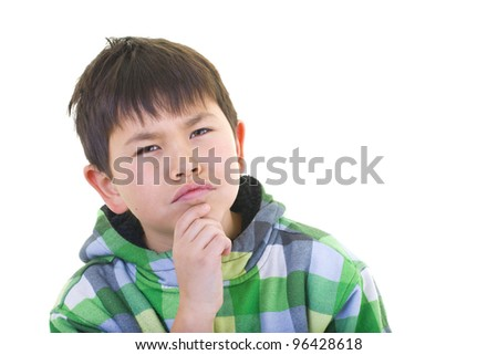 Cute young boy deep in thought isolated on white background