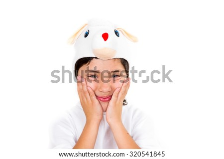Cute young boy dressed in bunny costume making adorable faces isolated over white background.