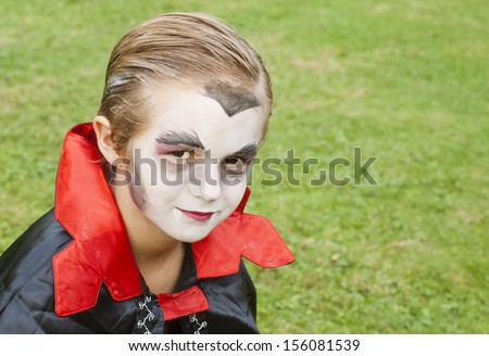 Cute, young boy dressed up as a vampire for Halloween - stock photo