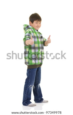 Cute young boy giving the two thumbs up sign isolated on white background