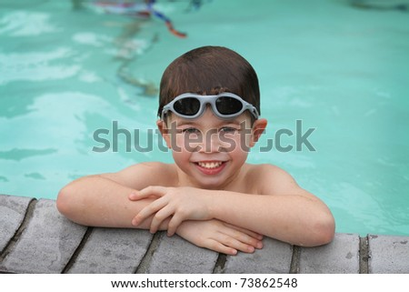 cute young boy in a swimming pool