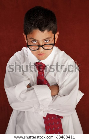 Cute young boy in his father's shirt and eyeglasses - stock photo