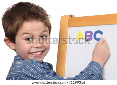 cute young boy learning the ABC - stock photo