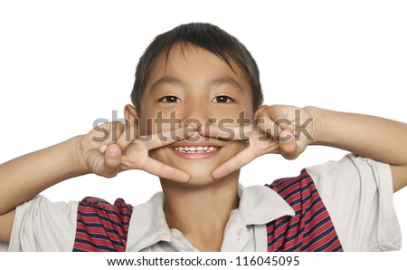 Cute young boy making a funny face