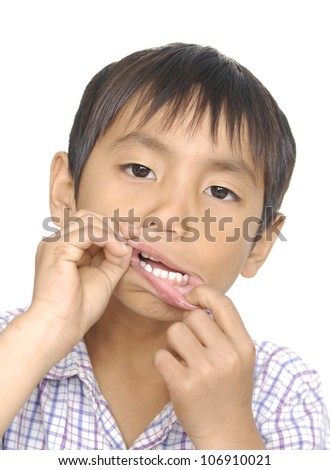 Cute young boy making a funny face, isolated on white - stock photo