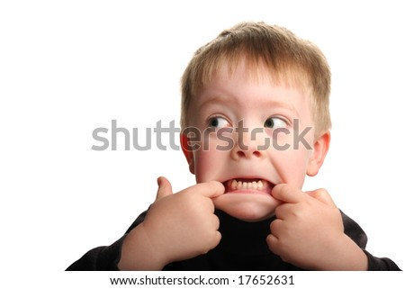 Cute young boy making a funny face, isolated on white