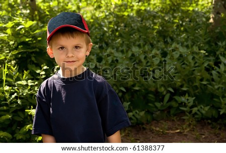 Cute, young boy outdoors. - stock photo