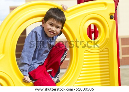 Cute young boy playing at the playground - stock photo