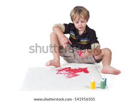 Cute young boy playing with water colors isolated on white background.  Creative education concept