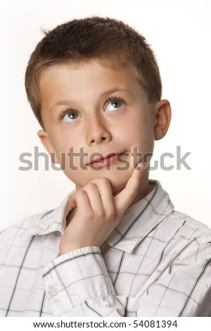 cute young boy thinking with white background - stock photo