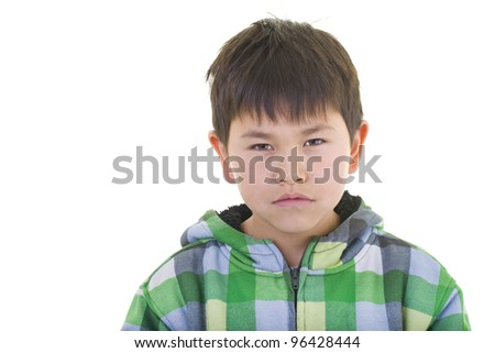 Cute young boy with a serious look isolated on white background - stock photo