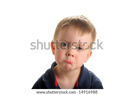 Cute young boy with blond hair and green eyes with sad or pouting face, isolated on white - stock photo