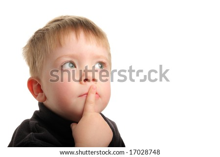 Cute young boy with blonde hair and green eyes looking up with finger on lips, wondering. - stock photo