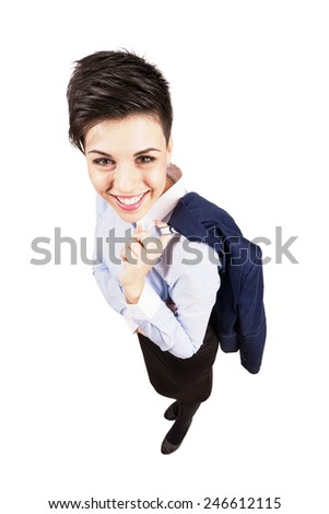 Cute young business woman smiling at camera while holding suit. High angle view wide lens full body length portrait isolated over white background. - stock photo