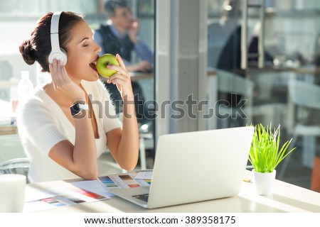 Cute young businesswoman is resting in office - stock photo